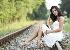 Cute young woman standing on a railroad Stock Photos