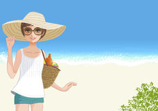 Cute young woman in straw wide brimmed hat smiling  at beach Royalty Free Stock Photo