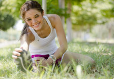 Cute young woman stretching Royalty Free Stock Images