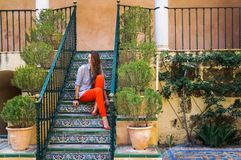 Cute young woman strolling along beautiful streets among old houses stock images