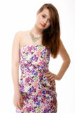 Cute young woman in summer dress on white Stock Images