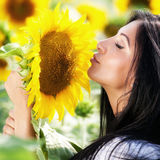Cute young woman and sunflower Royalty Free Stock Photos