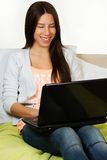 Cute young woman, surfing the internet Stock Photos