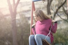 Reliving childhood, swinging in a park royalty free stock photos
