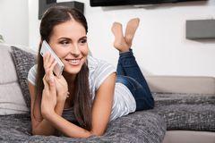 Cute young woman talking on a phone Stock Images