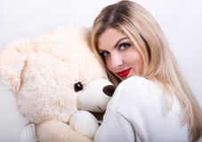 Cute young woman with a Teddy bear in his hands. Cute girl with teddy bear stock image