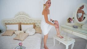 Female Model in Towel. Anxiously Looking at Camera and Upset, Holding Hands in stock photos