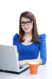 Cute young woman using laptop Stock Image