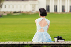 Cute young woman with vintage dress standing in the park Royalty Free Stock Image