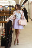 Cute young woman walking at the shopping center. Stock Photos