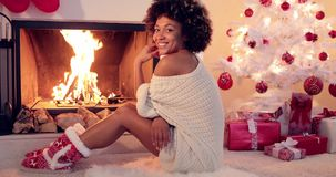 Cute young woman warming herself at the fire stock video