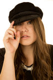 Cute young woman wearing a black European hat Stock Images
