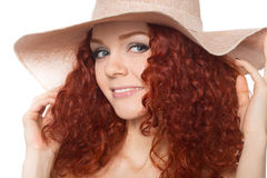 Cute young woman wearing a hat royalty free stock photos