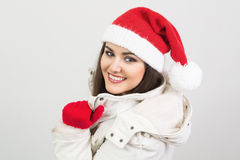 Cute young woman wearing Santa hat and gloves Stock Images