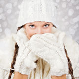 Cute young woman wearing white hat and gloves Royalty Free Stock Image