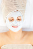 Cute young woman with white cream on her face Royalty Free Stock Image