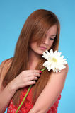 Cute young woman with white flower Royalty Free Stock Images