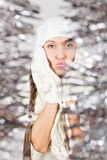 Cute young woman in white among sparkling Christmas decoration Royalty Free Stock Images