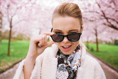 Cute young woman winking at camera Royalty Free Stock Images