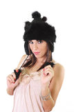 Cute young woman in winter fur hat royalty free stock photography