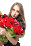 Cute young women with the flowers Royalty Free Stock Image