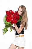 Cute young women with the flowers Stock Image