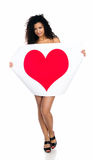 Cute young women with a red heart Stock Photography