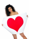 Cute young women with a red heart Royalty Free Stock Photos