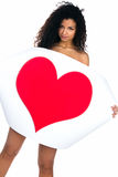Cute young women with a red heart Royalty Free Stock Image