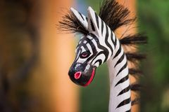 Cute zebra doll with copy space for text. Closeup cute zebra doll with blurred background and copy space for text. House interior, exterior decoration Stock Image