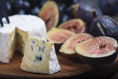 Free Cuted Blue Cheese, Fresh Fig Halfs And Grapes On Rustic Wooden Plate. Moody Scene With Selective Focus Stock Photography - 159249742