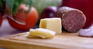 Cuted cheese and salami close up. 4K stock video footage