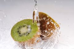Cuted kiwi with splashing water Royalty Free Stock Photography