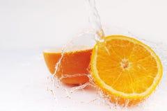 Cuted orange with splash Royalty Free Stock Image