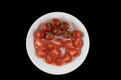 cuted tomato on dish with black background,top view. royalty free stock image