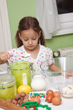 Cutee girl in kitchen Royalty Free Stock Photos