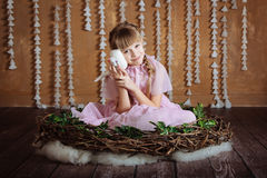 Cutel  little girl is  in a bird's nest (toned) Stock Photography