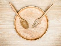 Cutelaria de madeira no fundo de madeira com vista superior Imagem de Stock Royalty Free