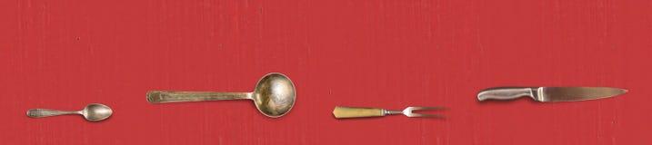 Cutelaria do vintage no fundo vermelho Imagens de Stock Royalty Free