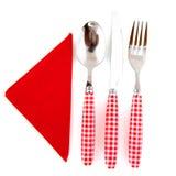 Cutelaria no vermelho Imagens de Stock Royalty Free