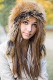 Cuteness en sombrero de piel. Fotografía de archivo