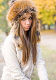 Cuteness in fur hat. Royalty Free Stock Image