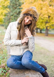 Cuteness in fur hat. Stock Images