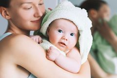 Cutest baby after bath with towel on head. Royalty Free Stock Photo