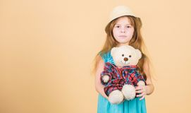 Cutest ever. Small girl straw hat hold teddy bear plush toy. In love with cute teddy bear. Happy childhood. Tender. Attachments. Kid little girl carefully hug stock photo