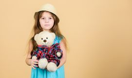 Cutest ever. Small girl straw hat hold teddy bear plush toy. In love with cute teddy bear. Happy childhood. Tender. Attachments. Kid little girl carefully hug stock images