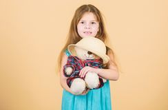 Cutest ever. Tender attachments. Small girl hold teddy bear plush toy straw hat. In love with cute teddy bear. Happy. Childhood. Kid little girl carefully hug royalty free stock photography
