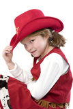 Cutest little cowgirl. Happy young girl with a cowboy hat and cowboy dress stock photo