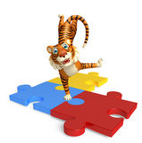 CuteTiger cartoon character with puzzle Stock Photo