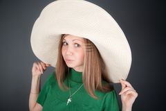 Nice girl in a big straw hat Stock Photo